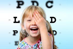 Girl having fun at vision test